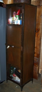 Image of Industrial one door glazed metal cabinet