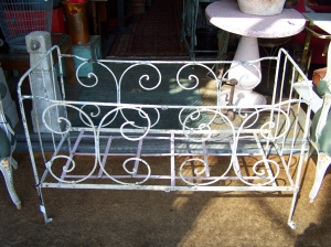Image of French antique foldup metal cot on castors
